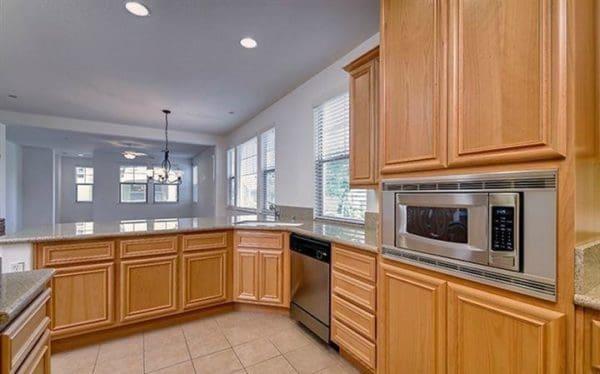 Kaye Swain Roseville Real Estate Agent sharing 1529 Marseille Lane Roseville kitchen dining living rooms a