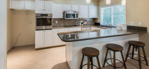 Great updates in this kitchen make it a nice social distance home