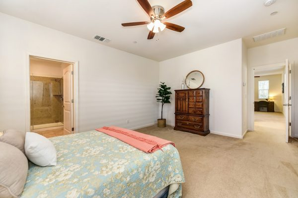 A fan and light for this beautiful bedroom in one of the homes for sale in West Roseville CA