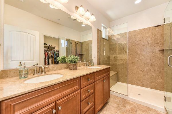 I love this gorgeous shower and 2 sinks in the master bathroom of one of Roseville's homes for sale with a loft