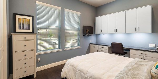Check out this bedroom with desk and cupboards along the sides and plenty of room