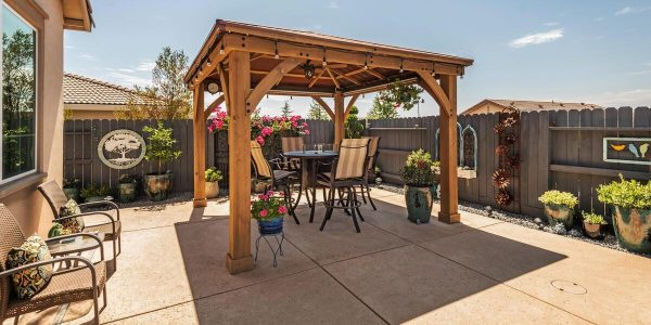 Enjoy your pergola outside on your delightful patio in one of the lincoln ca homes for sale with pool