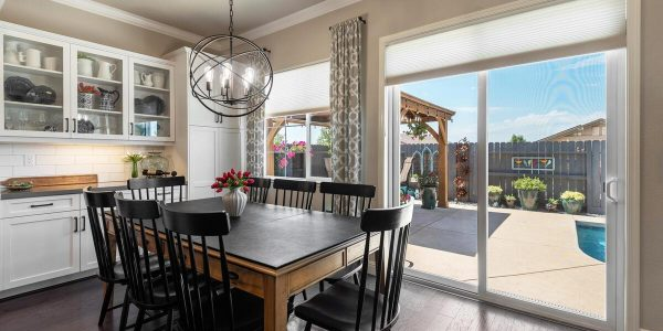 Gorgeous kitchen overlooks refreshing swimming pool in one of the 4 bedroom houses for sale in lincoln ca