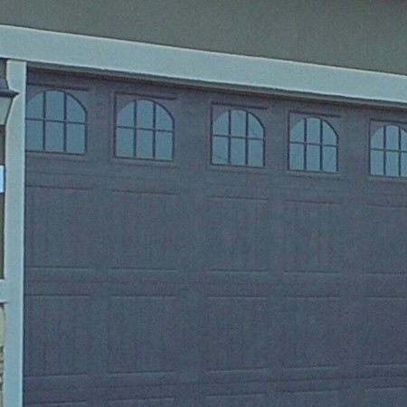 Could a third car space be hiding behind this two car garage door-via Kaye Swain Roseville CA REALTOR